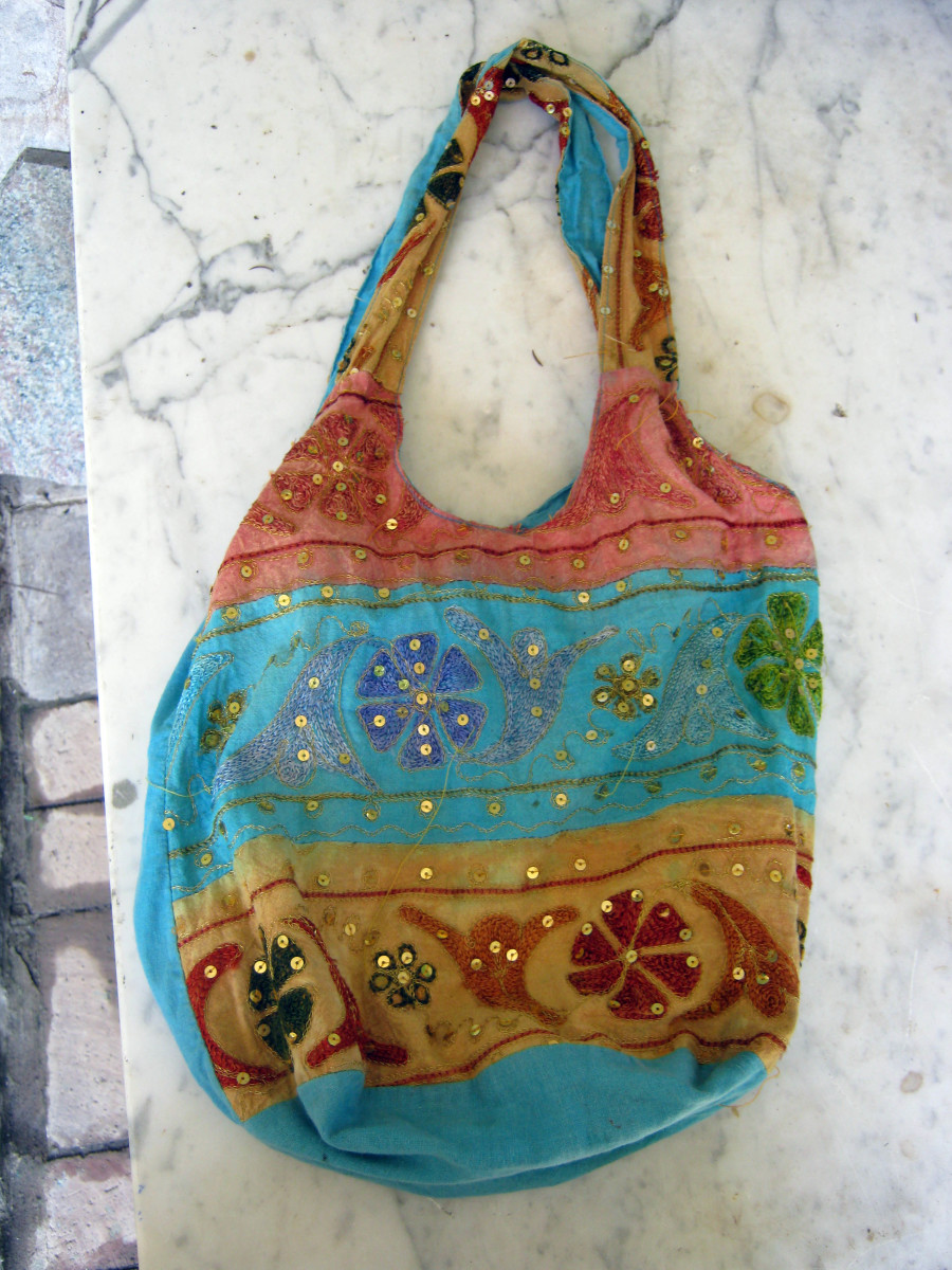 Hippie style bag includes exotic elements, different fabrics, mirrors, and embroidery