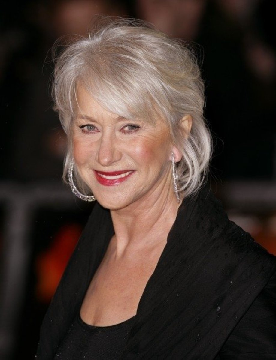 Helen Mirren with softly controlled bob, long full bangs. Helen Mirren's free spirit look in a longer length bob