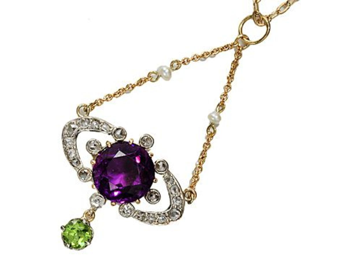 Amethyst Suffragette Pendant courtesy of The Three Graces on Ruby Lane