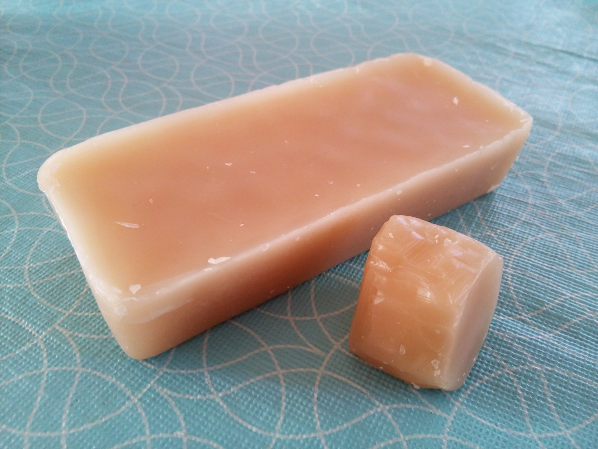 A slab of beeswax and a leftover used beeswax.