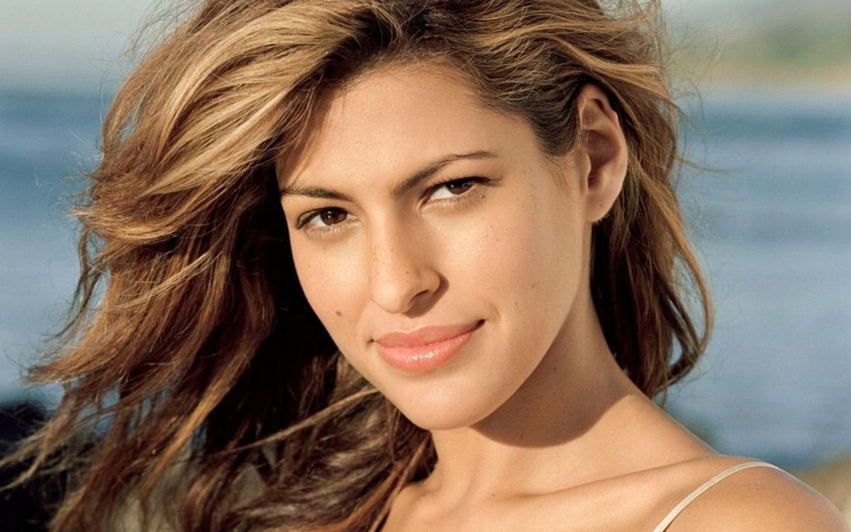 Eva Mendes with golden, sandy blonde hair.