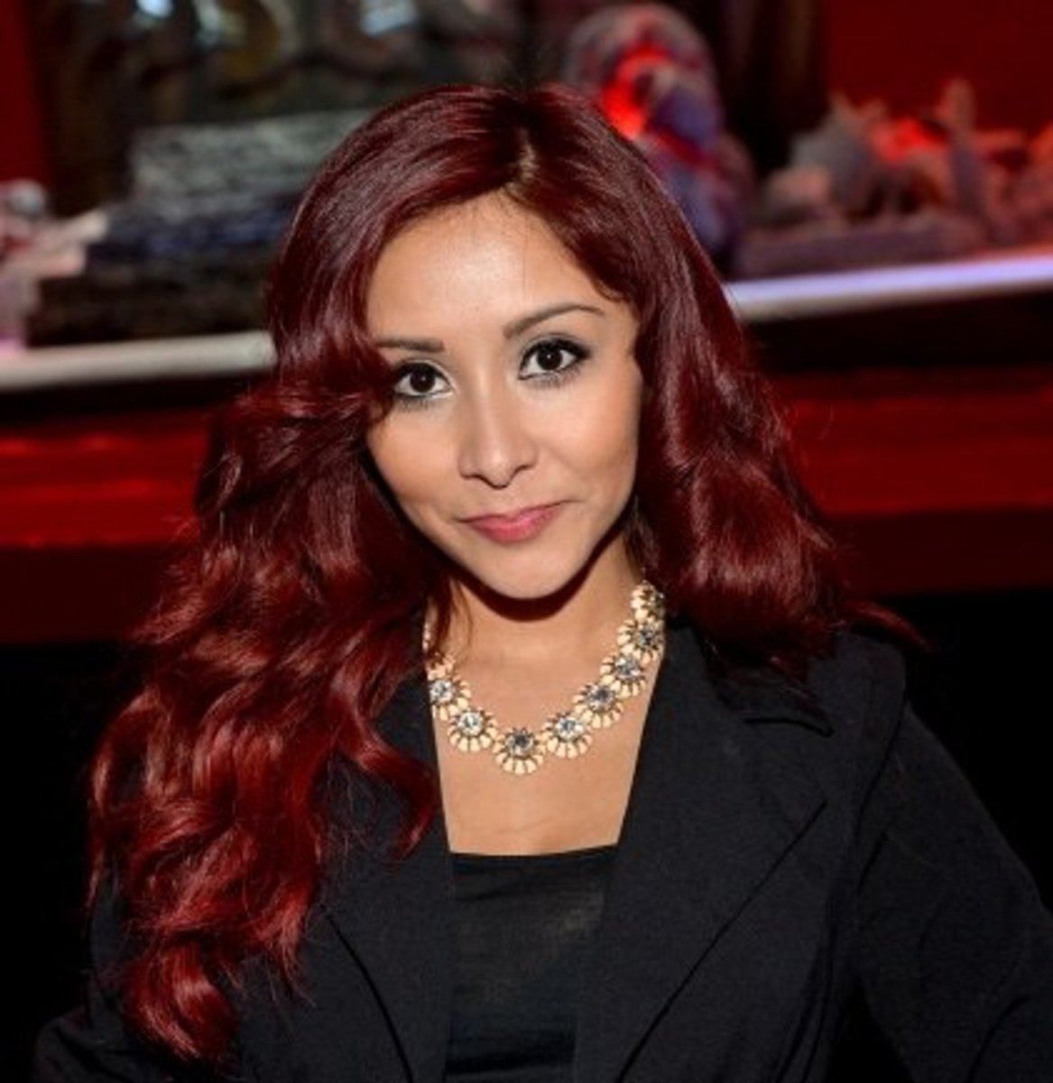 Snooki with mahogany hair and olive skin tone.