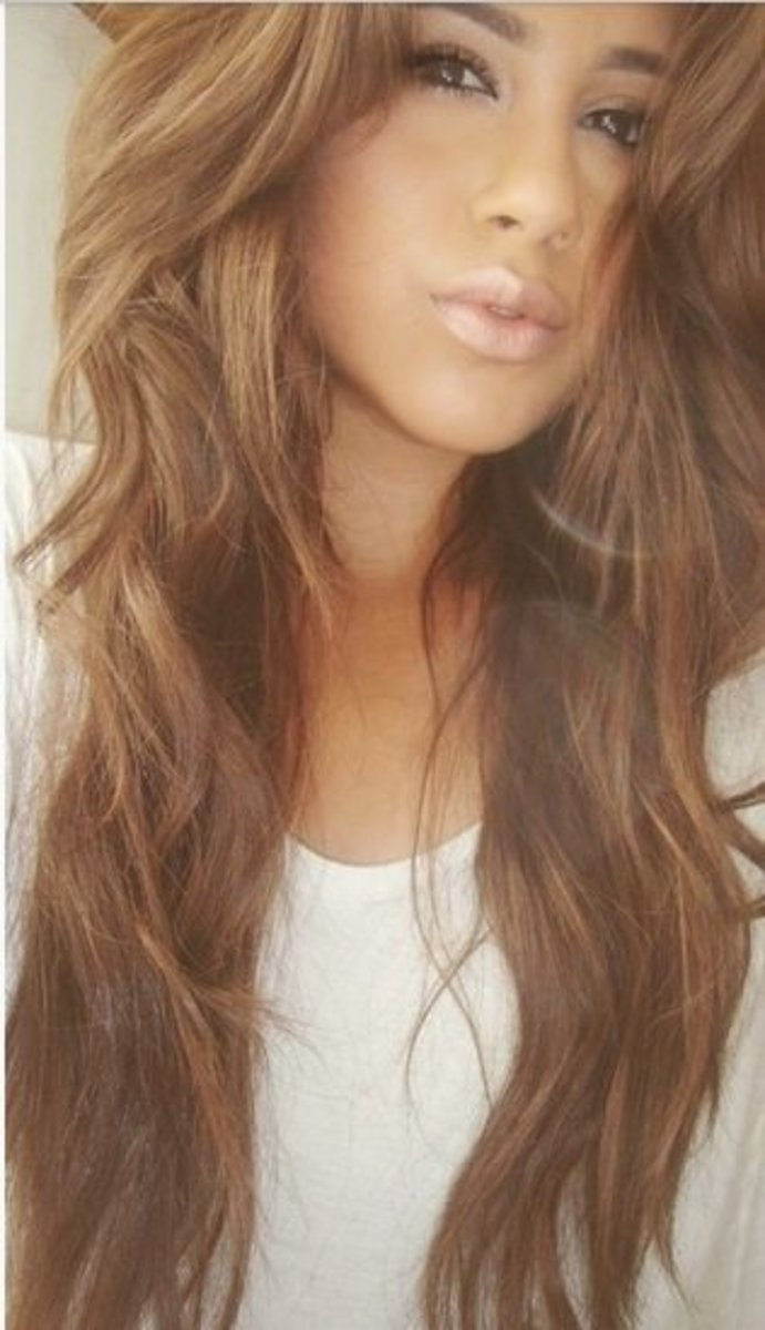 Subtle blonde highlights on brown hair.