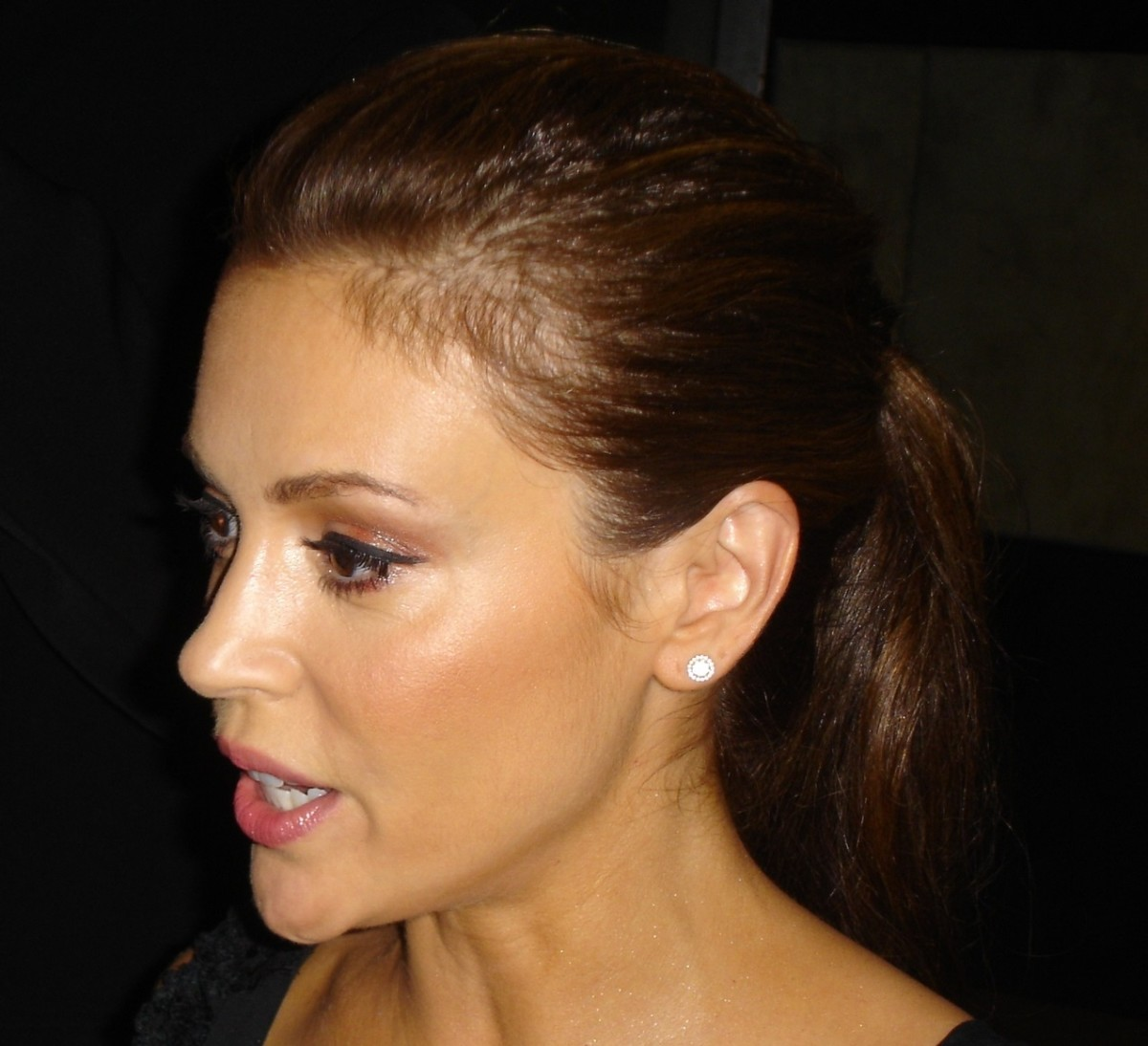Alyssa Milano with a dark brown hair color.