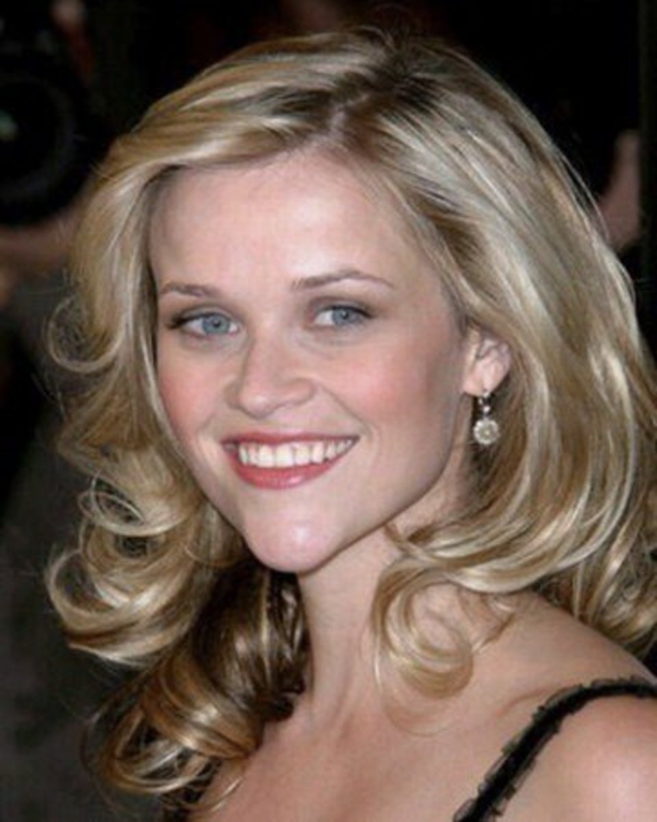 Reese Witherspoon with light ash blond hair.