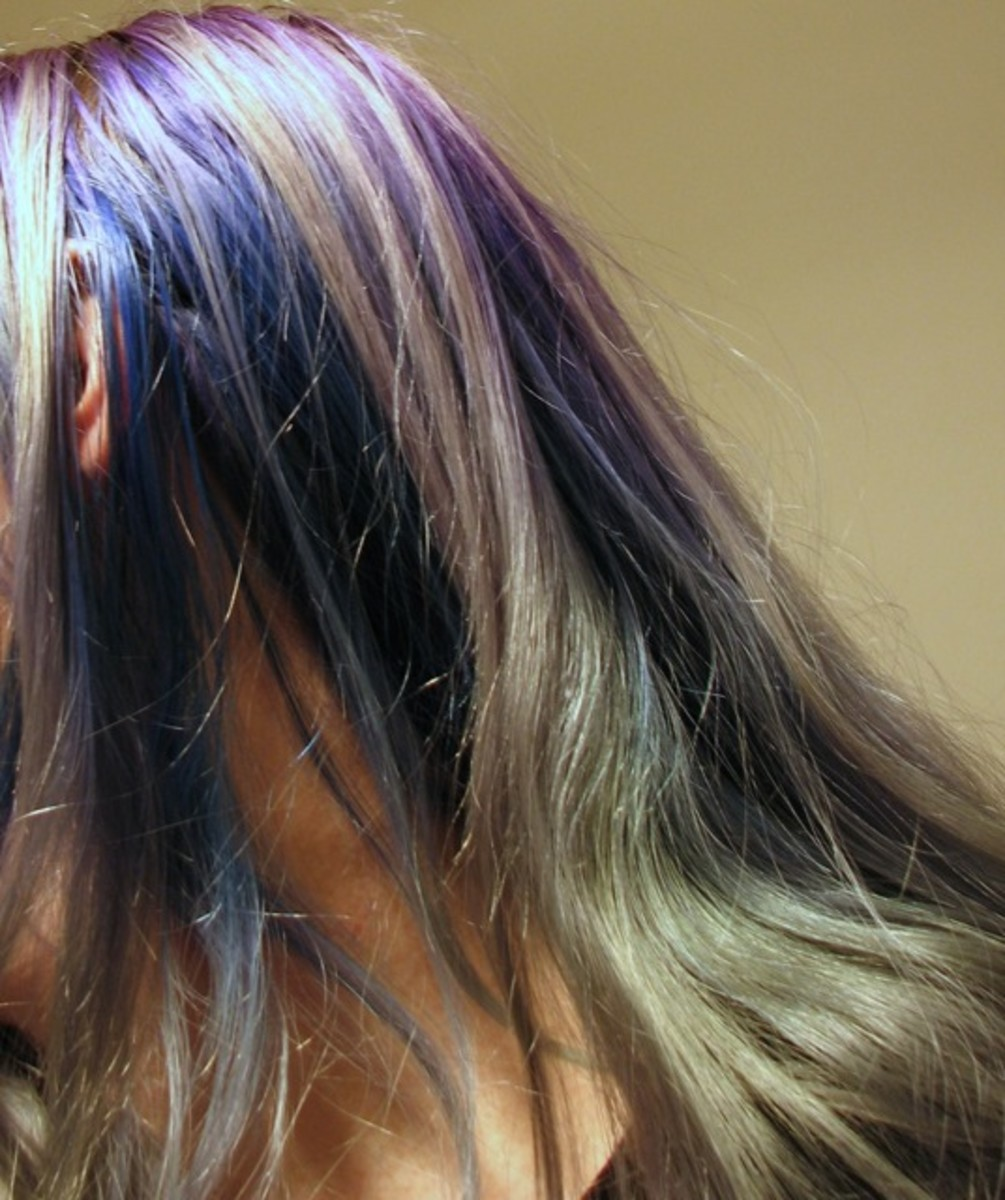Over 2 months after dying, faded in stripes. The hair underneath is still dark blue, because it isn't exposed to the sun.