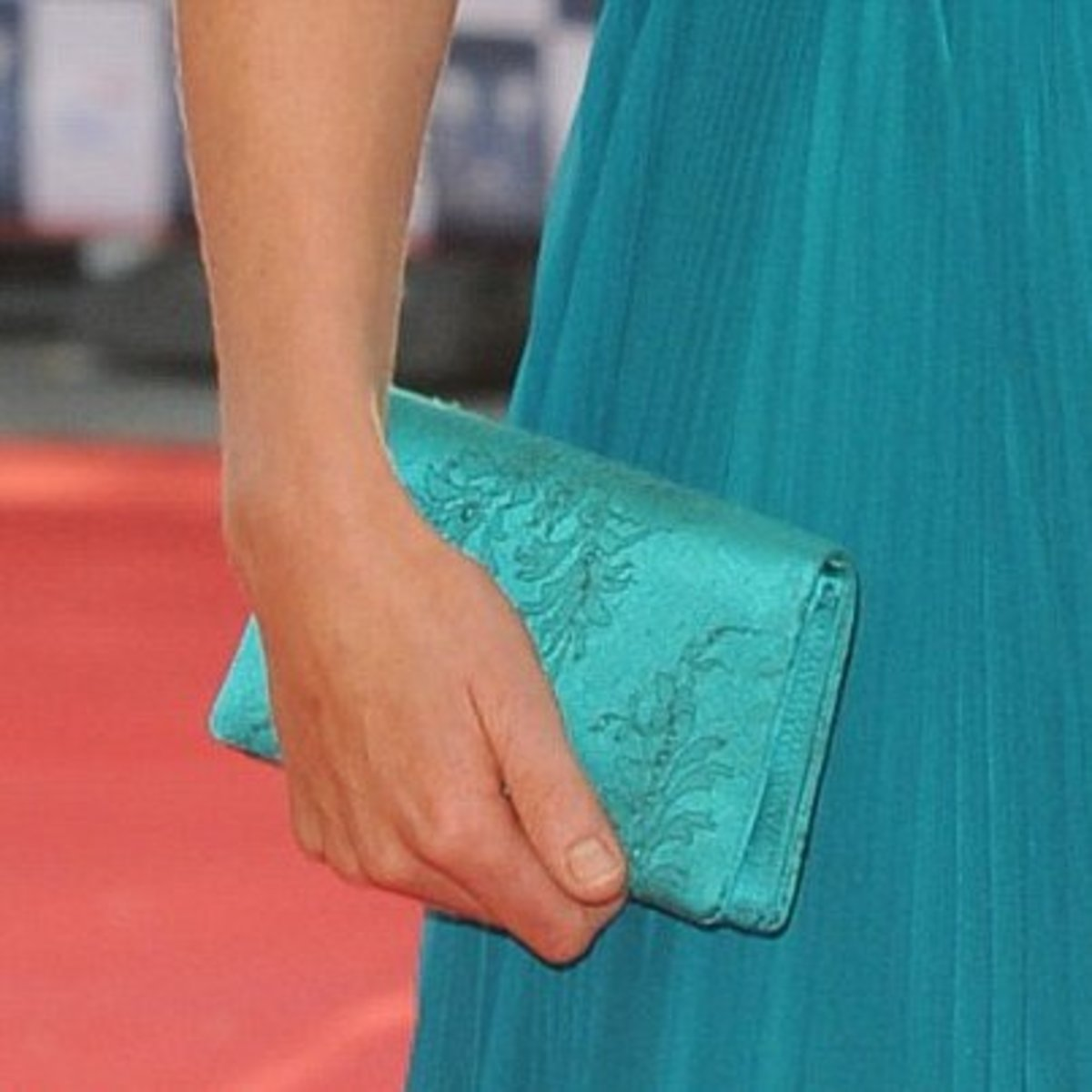 The clutch subtly blends in with Kate's dress.