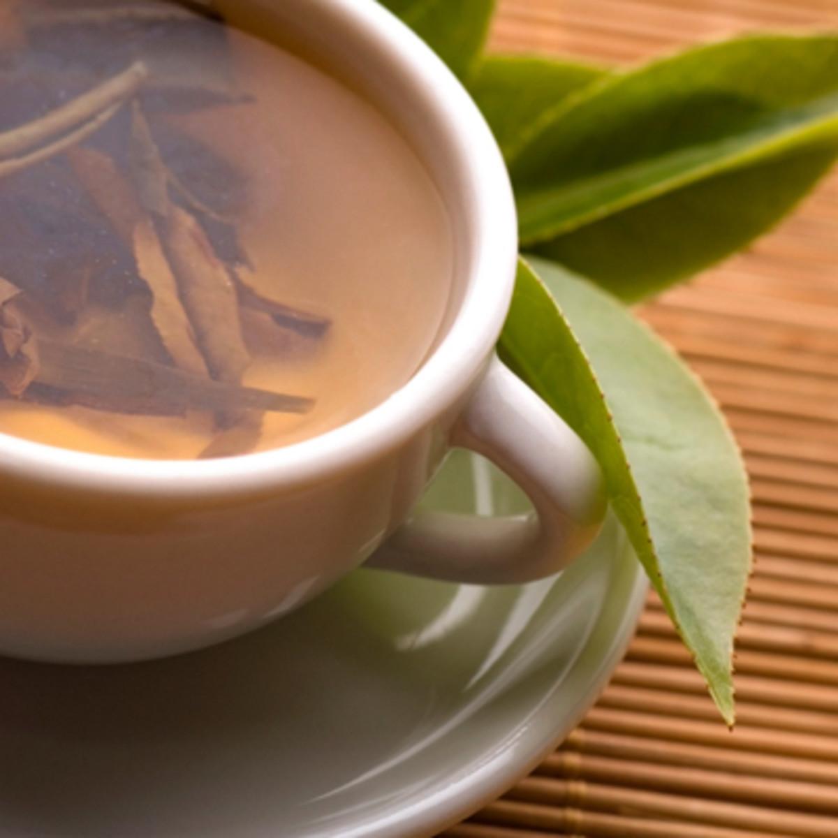 Green tea brewed from loose tea leaves.