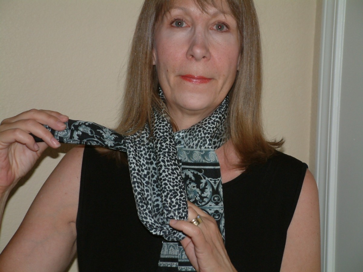 Insert one end of the scarf through the loop.