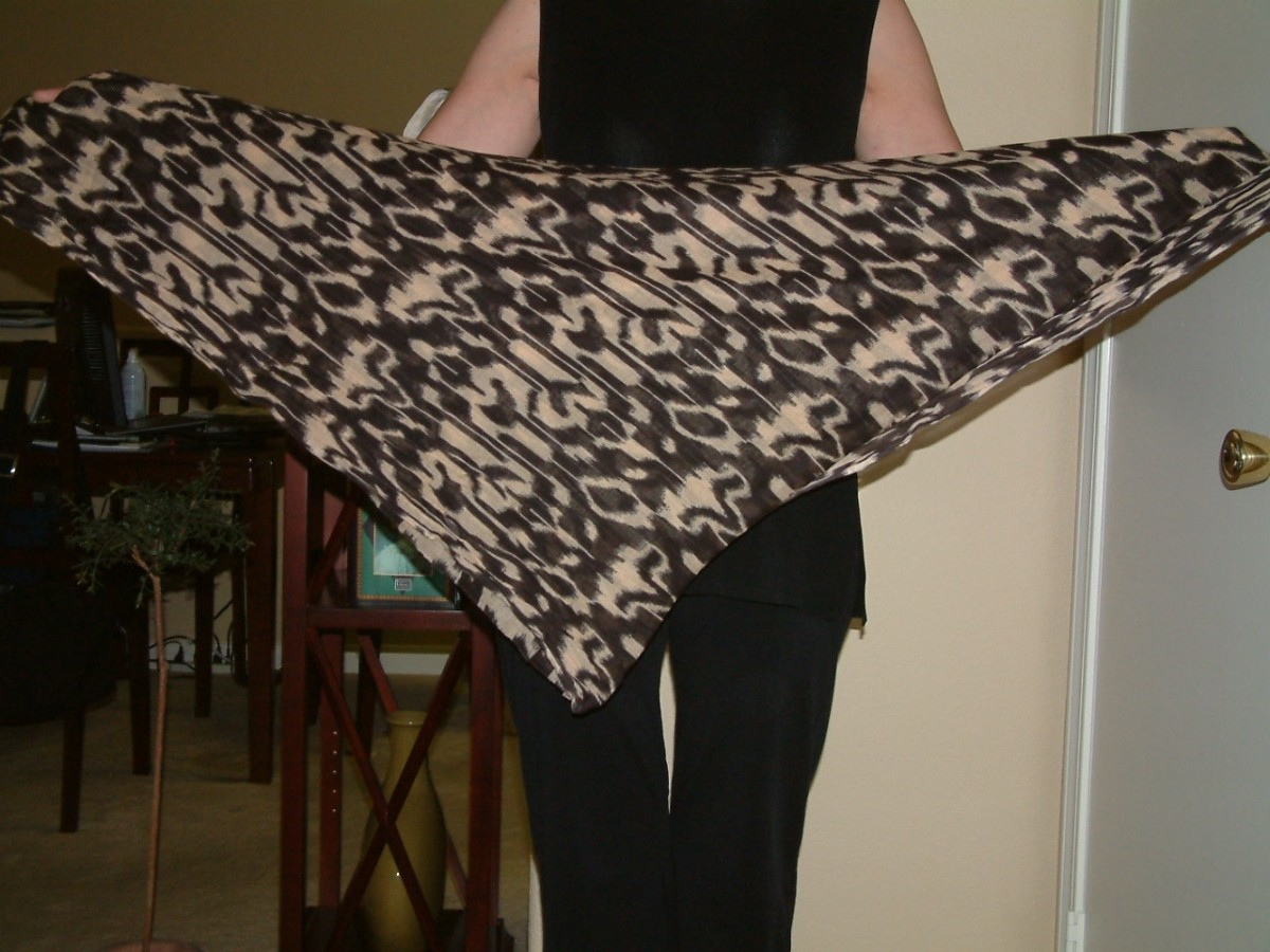 Fold the scarf into a triangle.