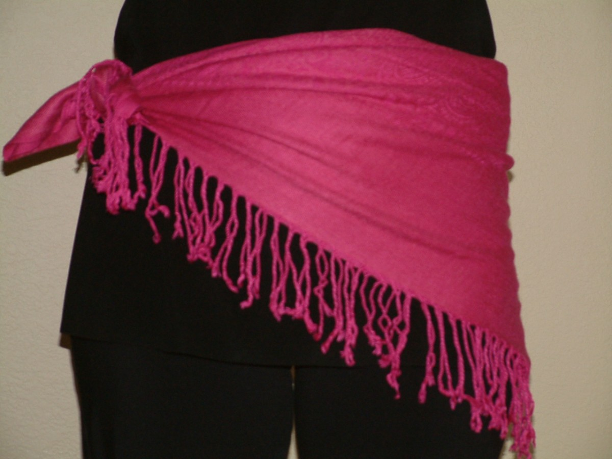 Double knot the scarf to secure at the hip for a versatile hip scarf for any outfit!