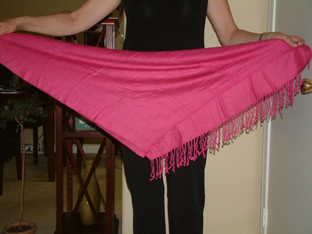 Fold the scarf into a triangle.