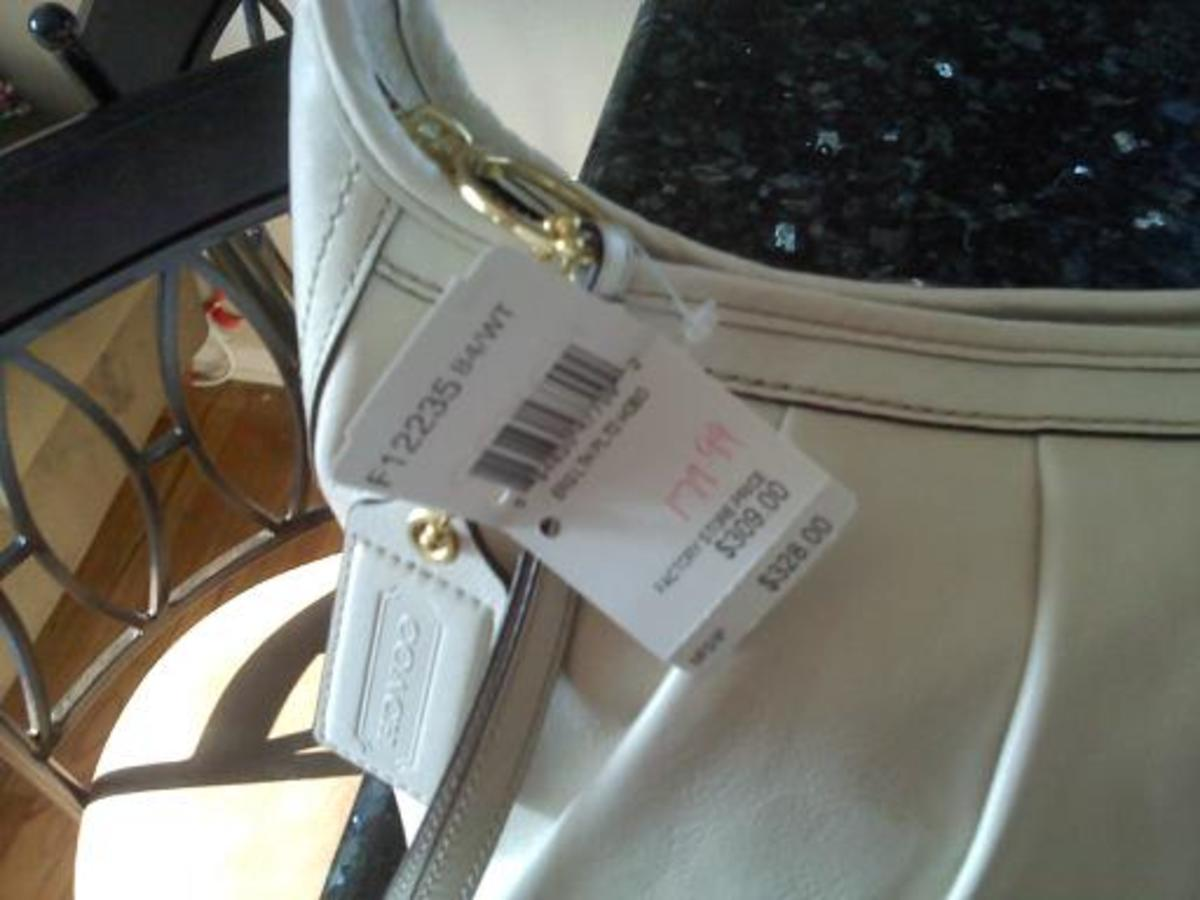 REAL Coach sales tag. Notice how the tag is looped through the hardware.