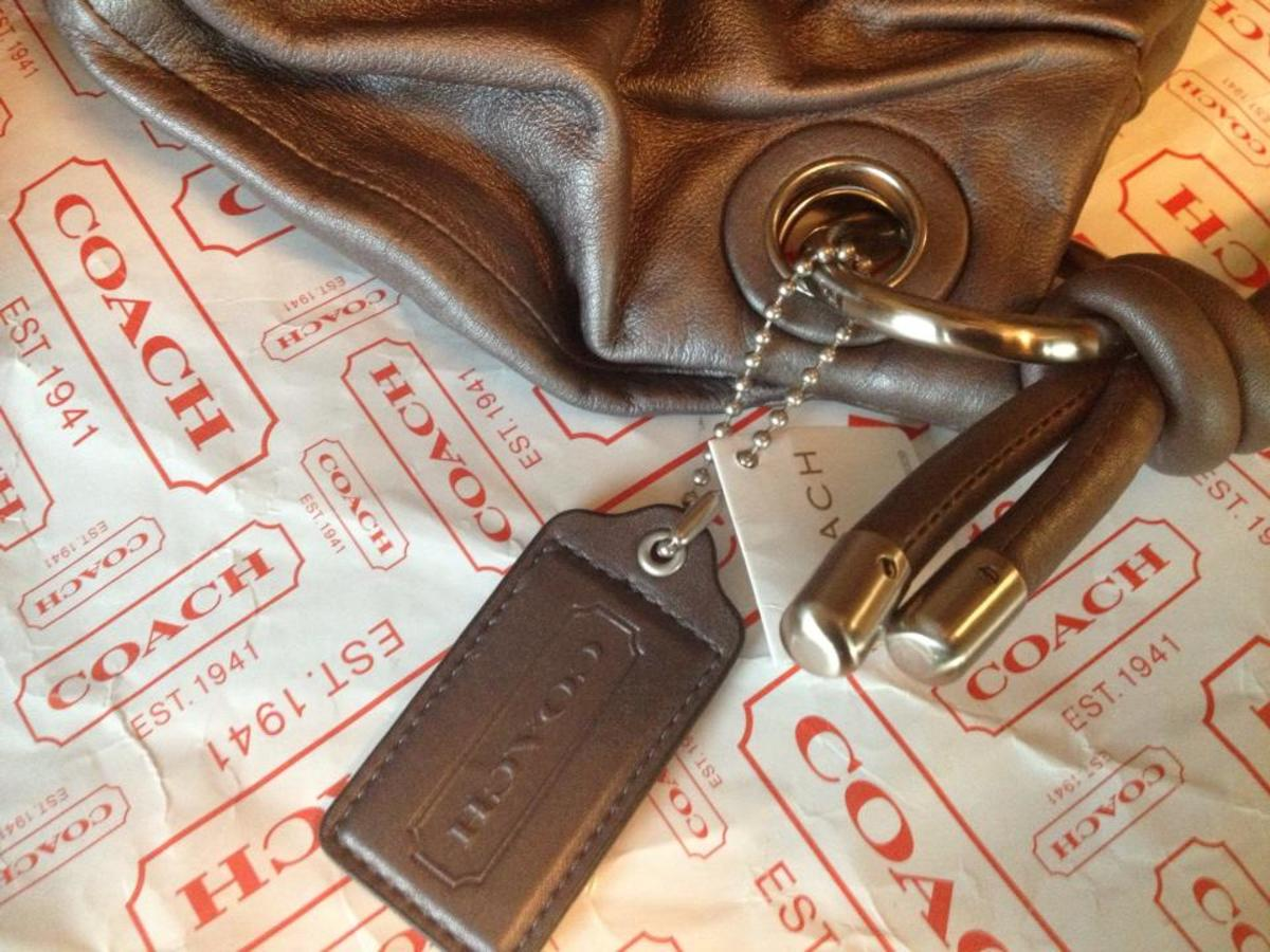 Lone Coach embossed leather hangtag. REAL