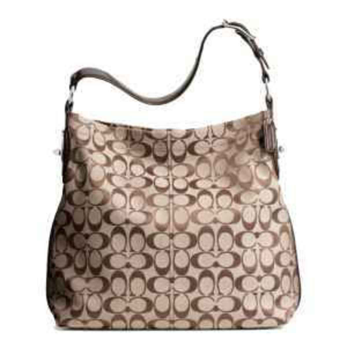 REAL Coach signature C material. The C's can be split right down the middle of the purse.