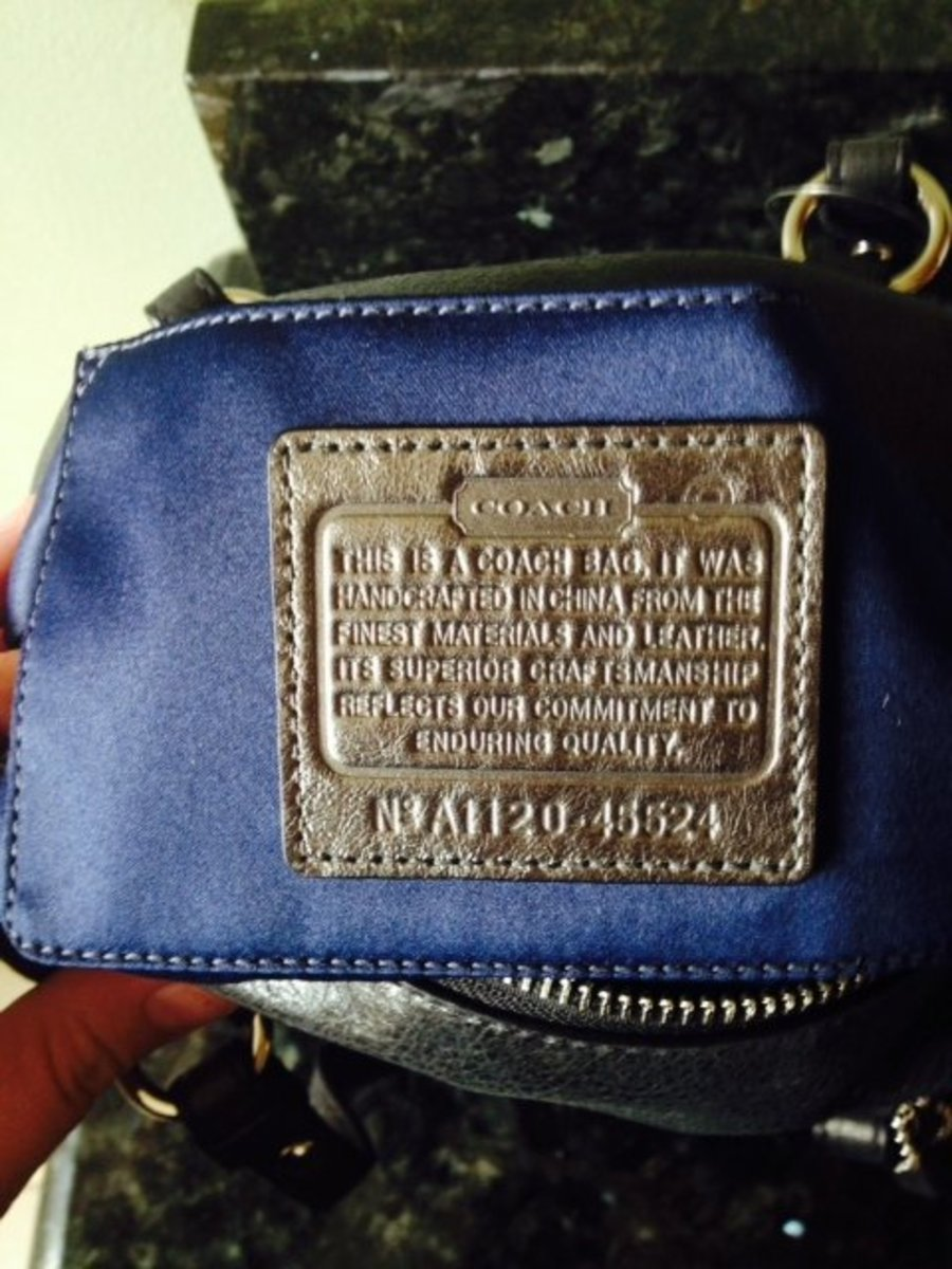 Smaller Coach purse with a Coach leather creed patch inside. This is #45524, Coach Juliette Mini Satchel Bag.