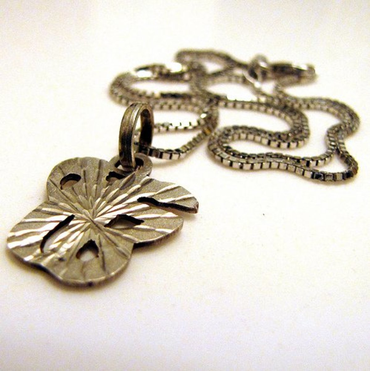 Box chain necklace with pendant.