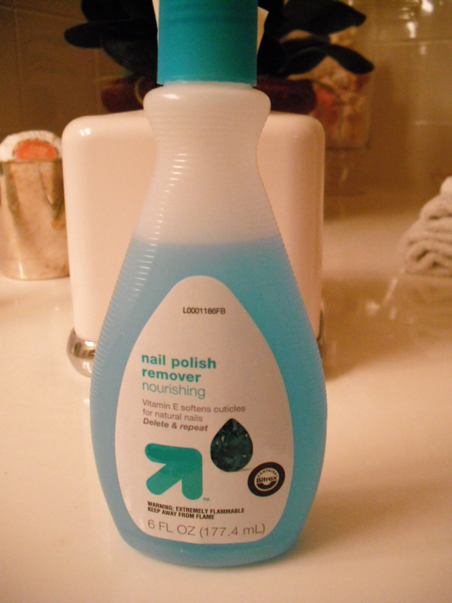 Nail polish remover is a temporary fix for thick polish.
