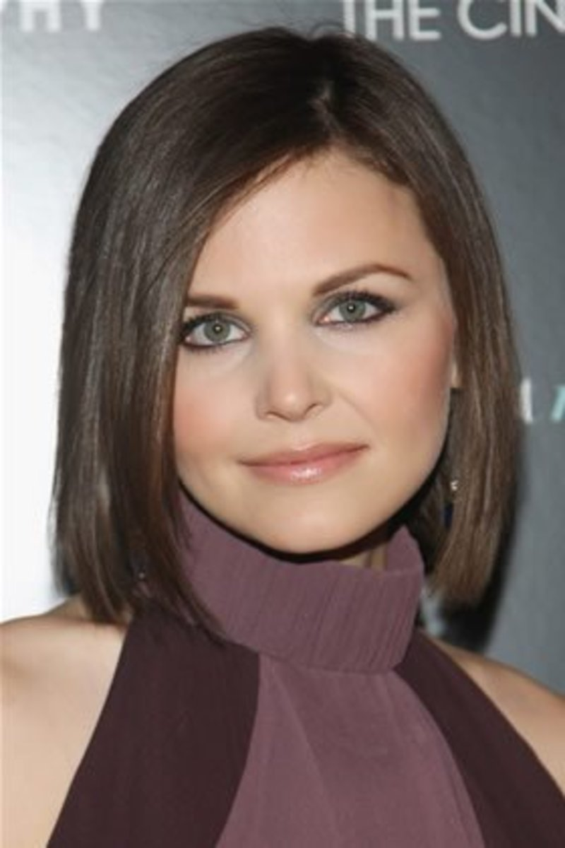 This sleek style makes her face appear longer and is very classy.