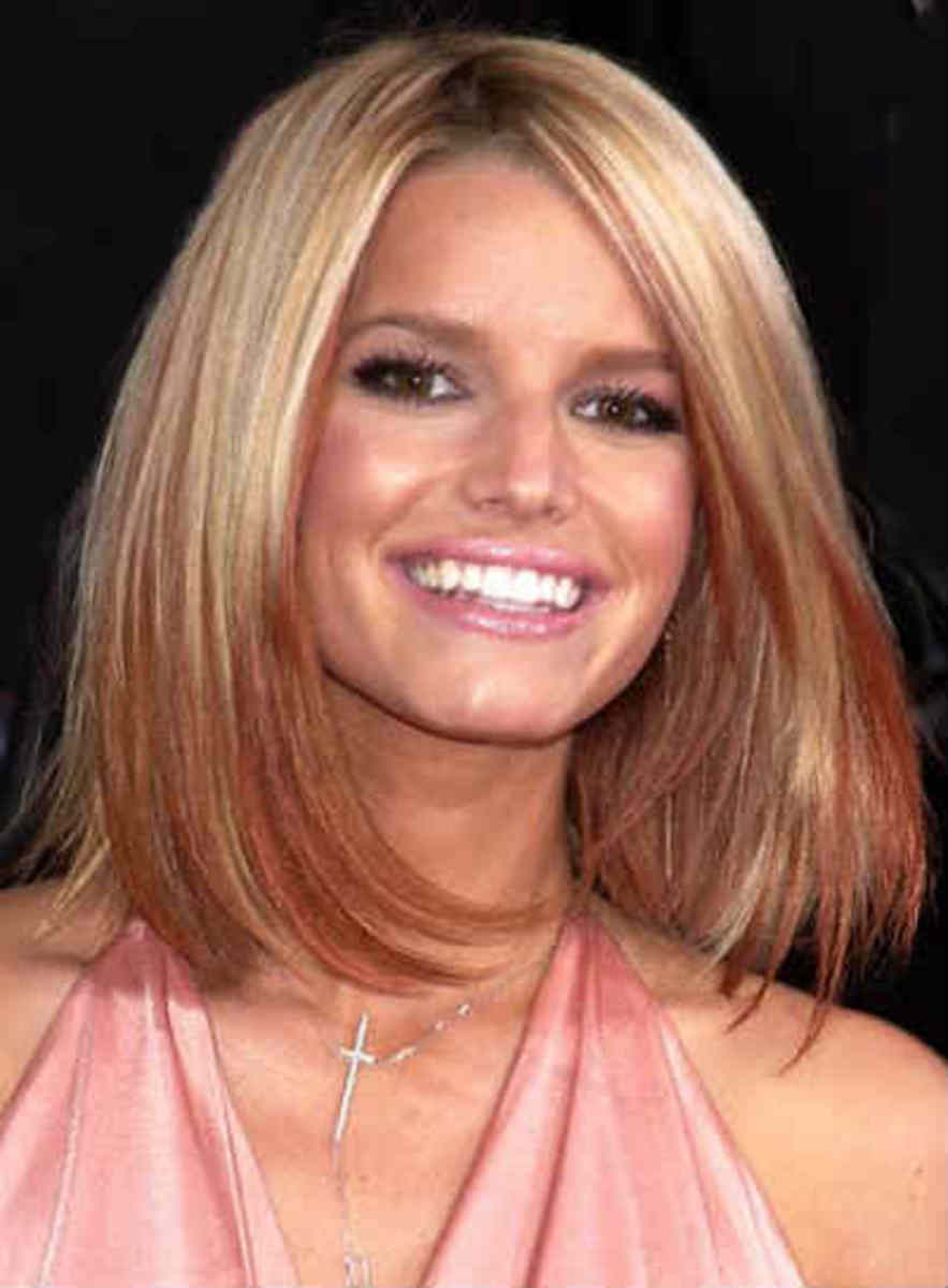 This is a great length for a rectangular face with just a few long layers in it.  It really compliments her overall look.