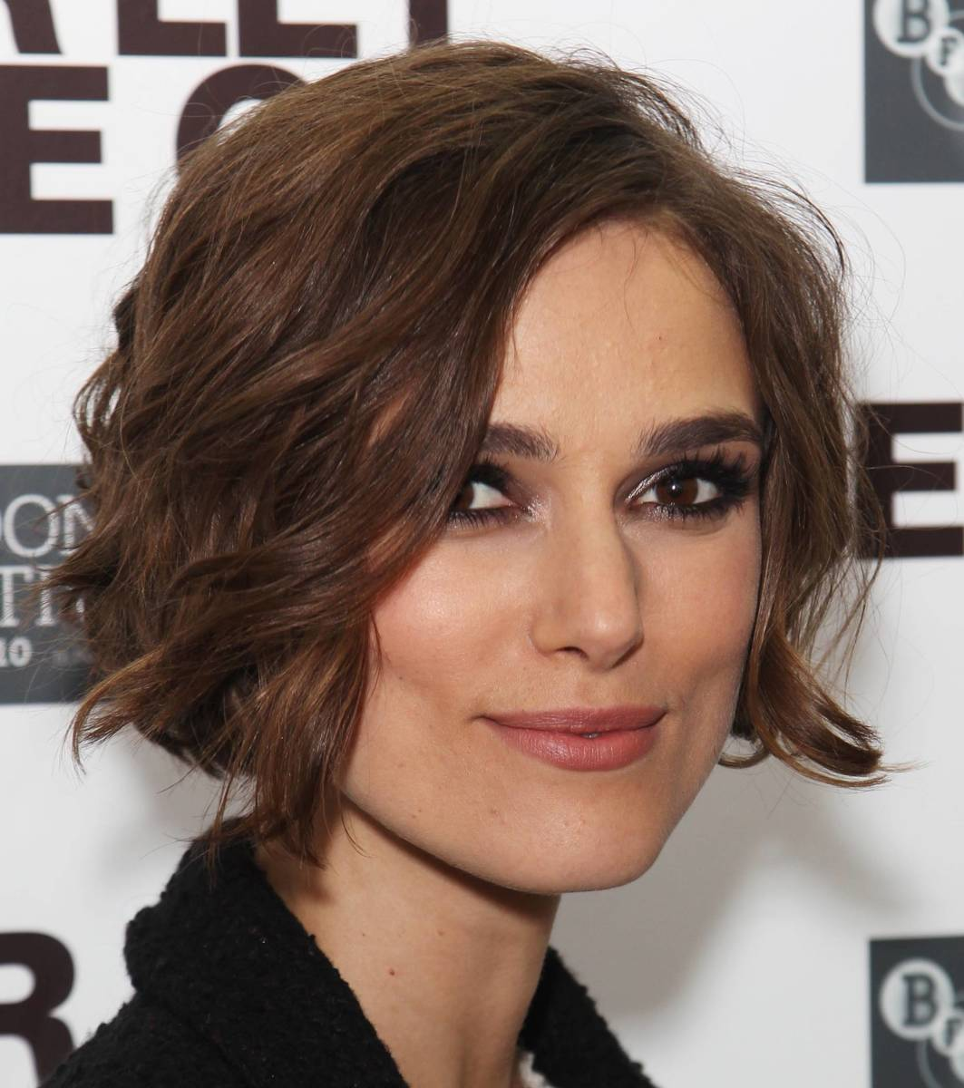 The cut appears to be at the jawline as stated not to do, however the soft curls in her hair balance it out making it a beautiful style for her face.