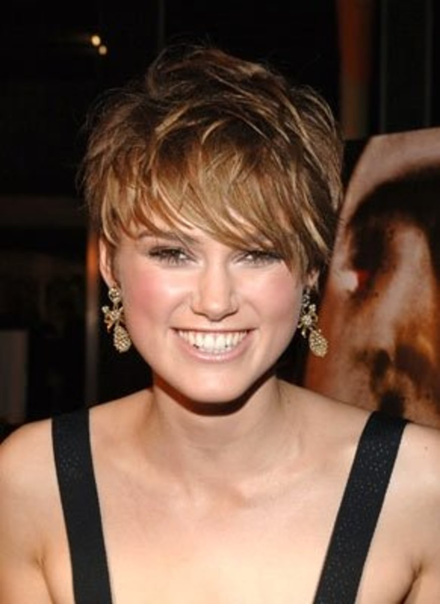 A beautiful, layered short cut with not too much volume is perfect with her face.