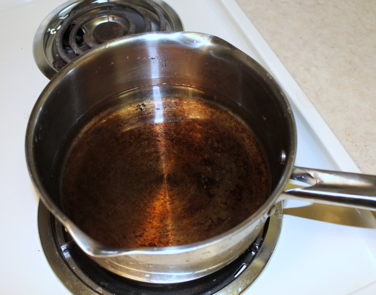 Put an inch or two of water in your larger pot and heat on high.