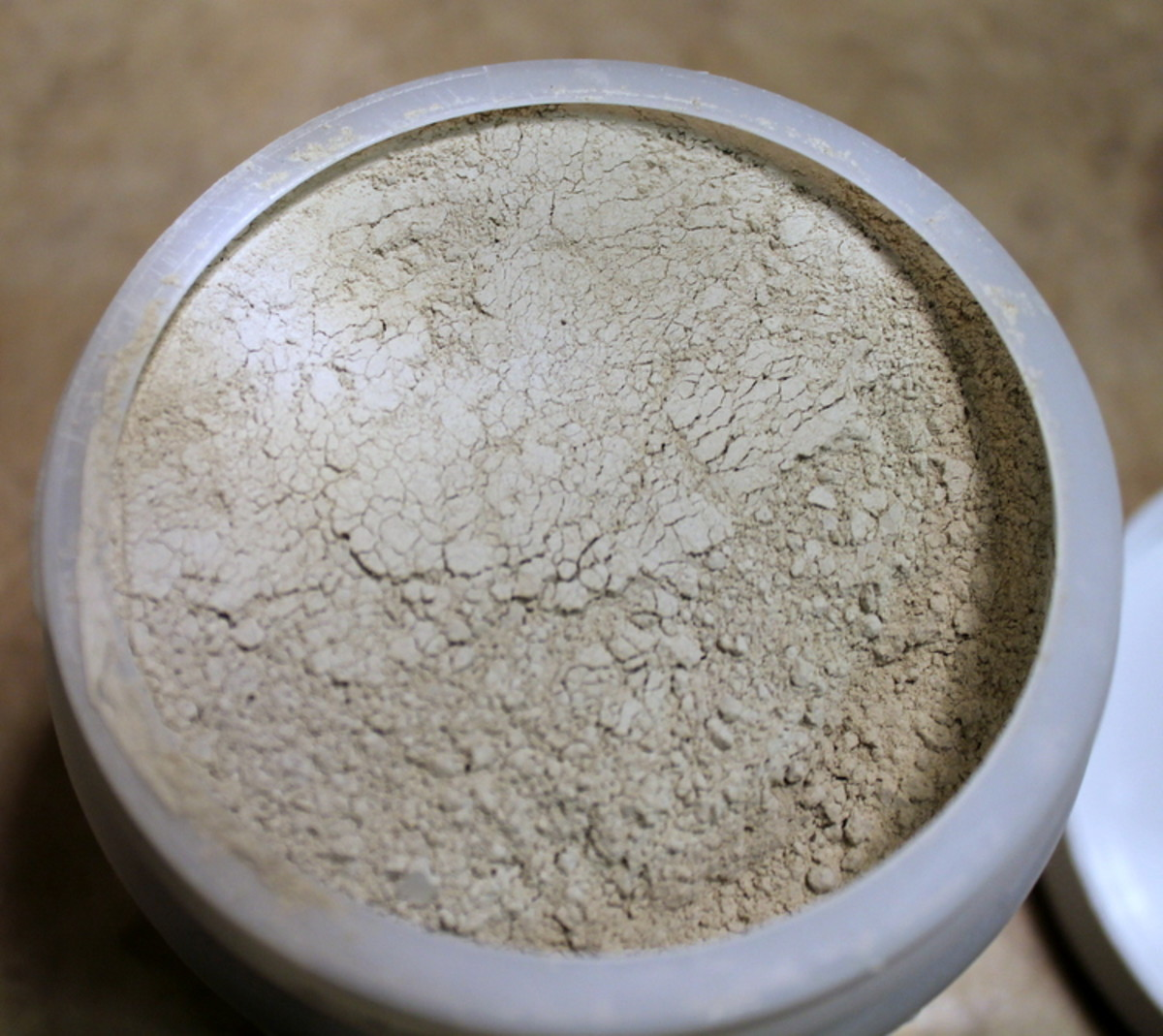 Bentonite clay looks white, but it turns green when mixed in.