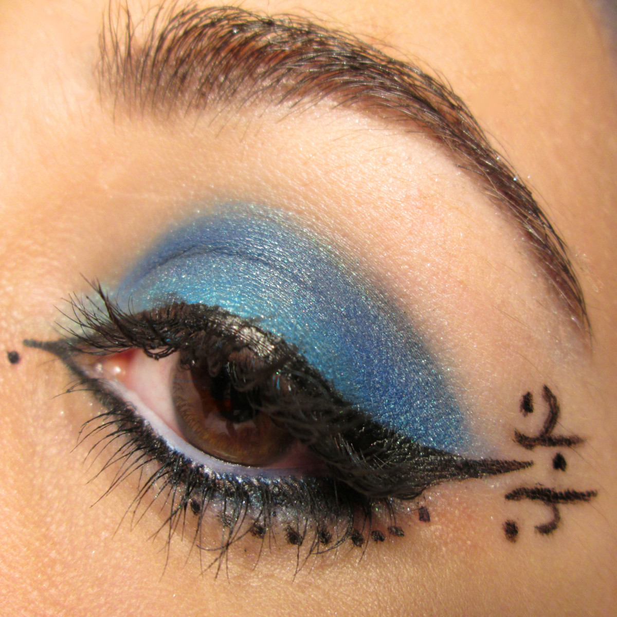 Liquid eyeliner is best when drawing tiny details around your makeup.