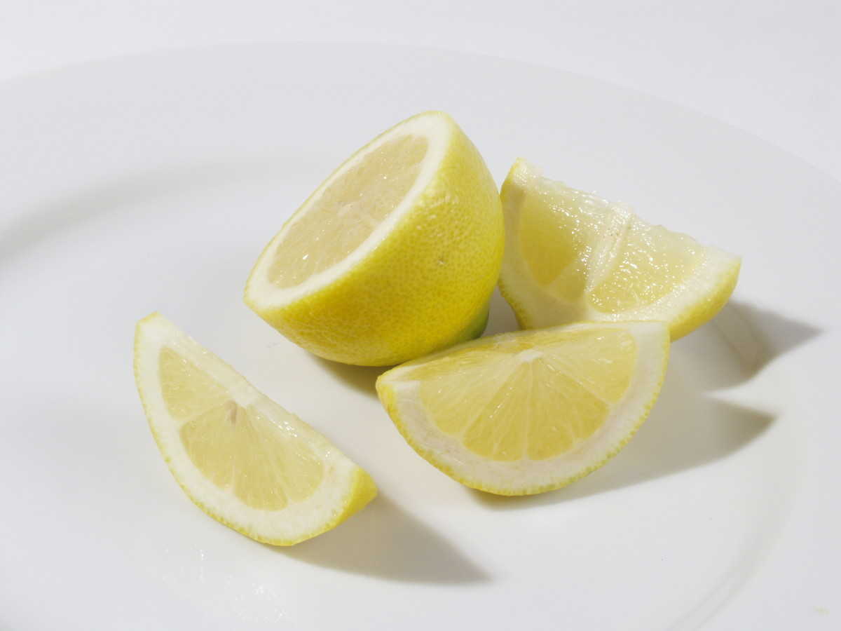 The acids in lemon and other citrus fruit help exfoliate and clear the skin.
