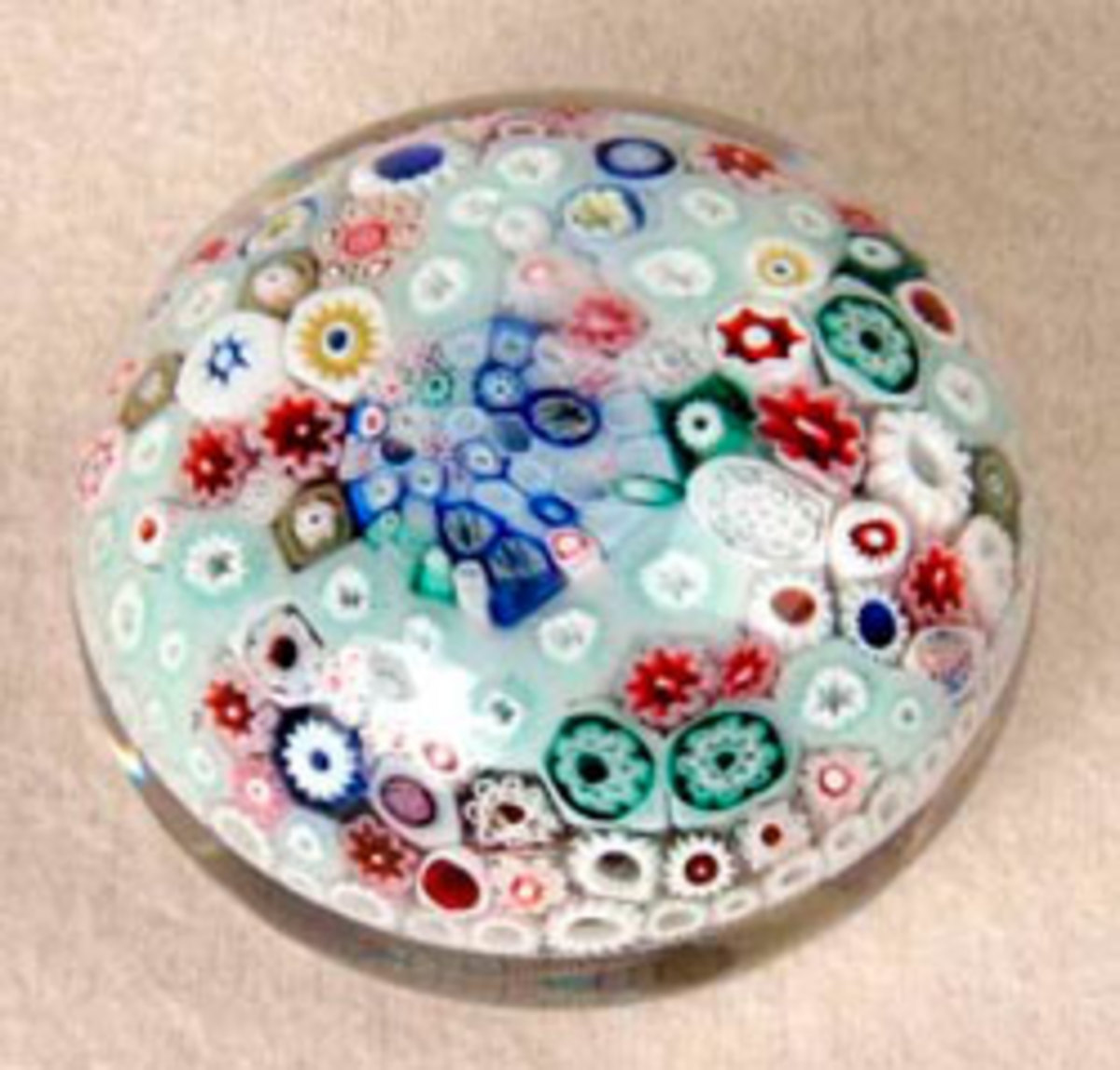 A rare, antique baccus concentric millefiori paperweight sold at auction for $4200 US.