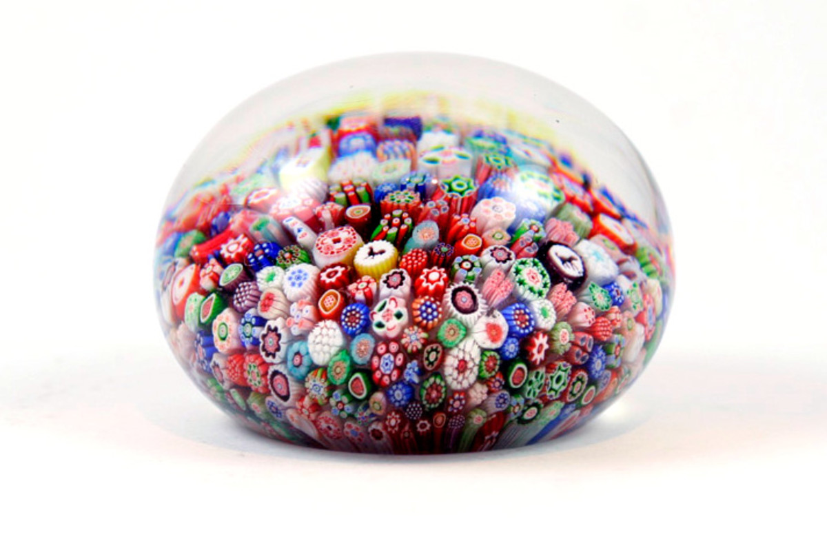 An antique baccarat millefiori paperweight with Gridel silhouette canes.