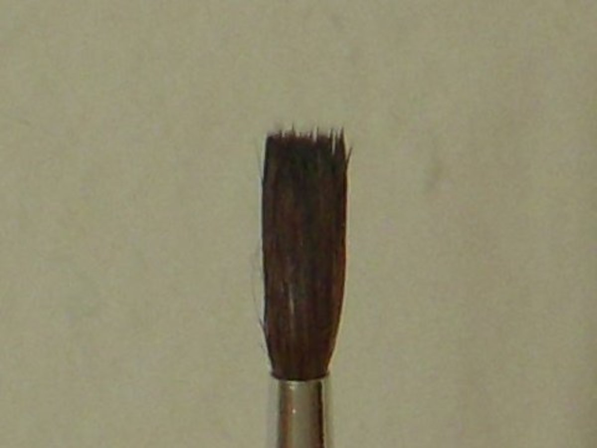 Art brush, #2 round, with ends blunted.