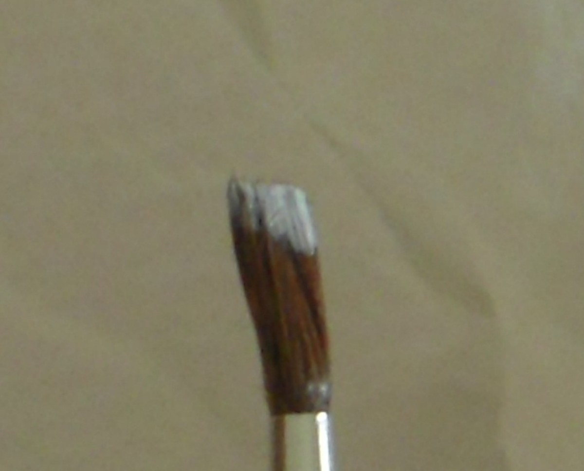 Load a #2 round brush, with ends blunted, with white polish.
