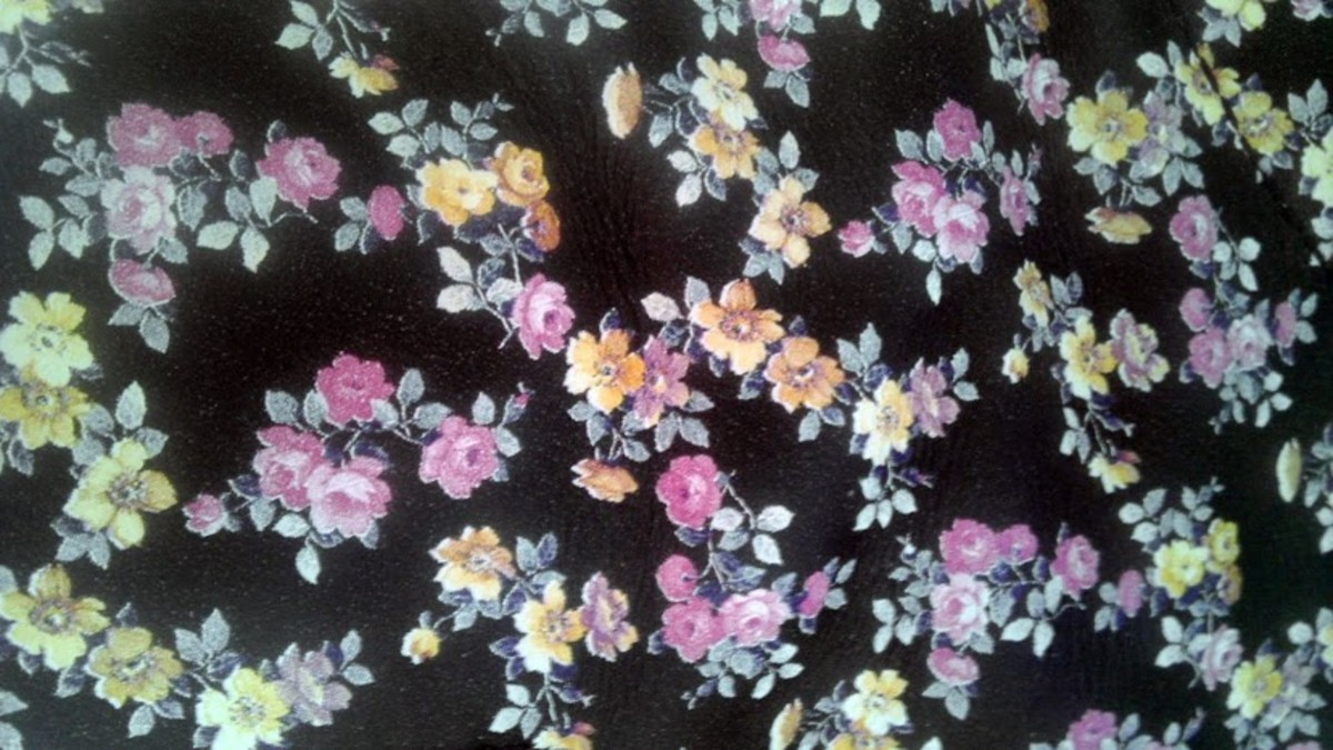 The lovely Mini Tydee pattern of tiny yellow, pale pink, and lavender flowers on black leather.