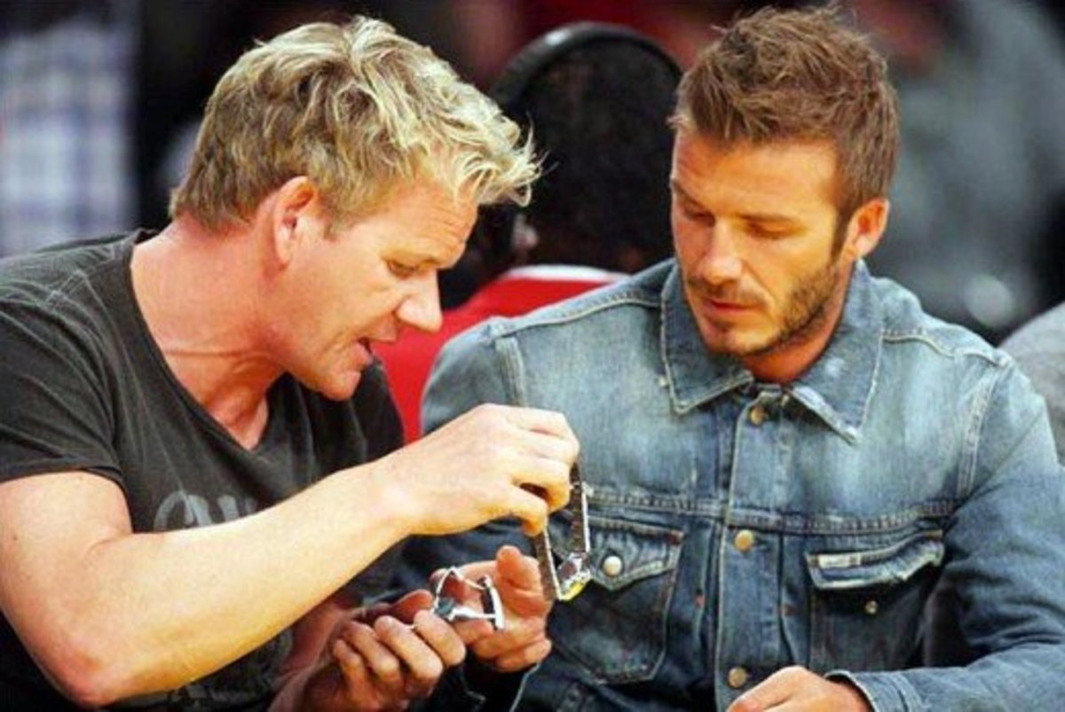 Chef Gordon Ramsay and Beckham, seen exchanging watches at a Laker's game. Beckham appears to have an eye for timepieces.