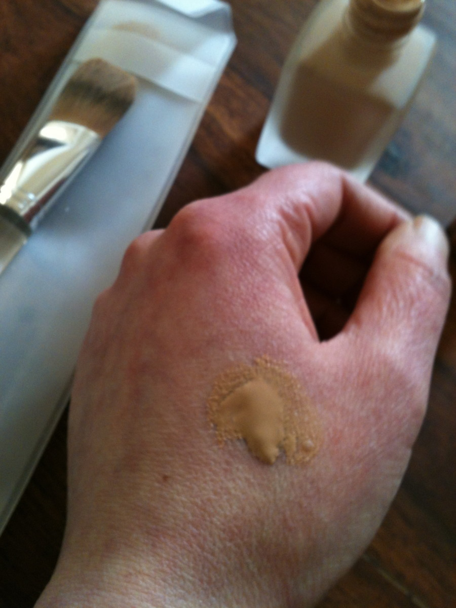 Use the back of your hand as a palette for a small amount of liquid foundation. Photo ©Redberry Sky
