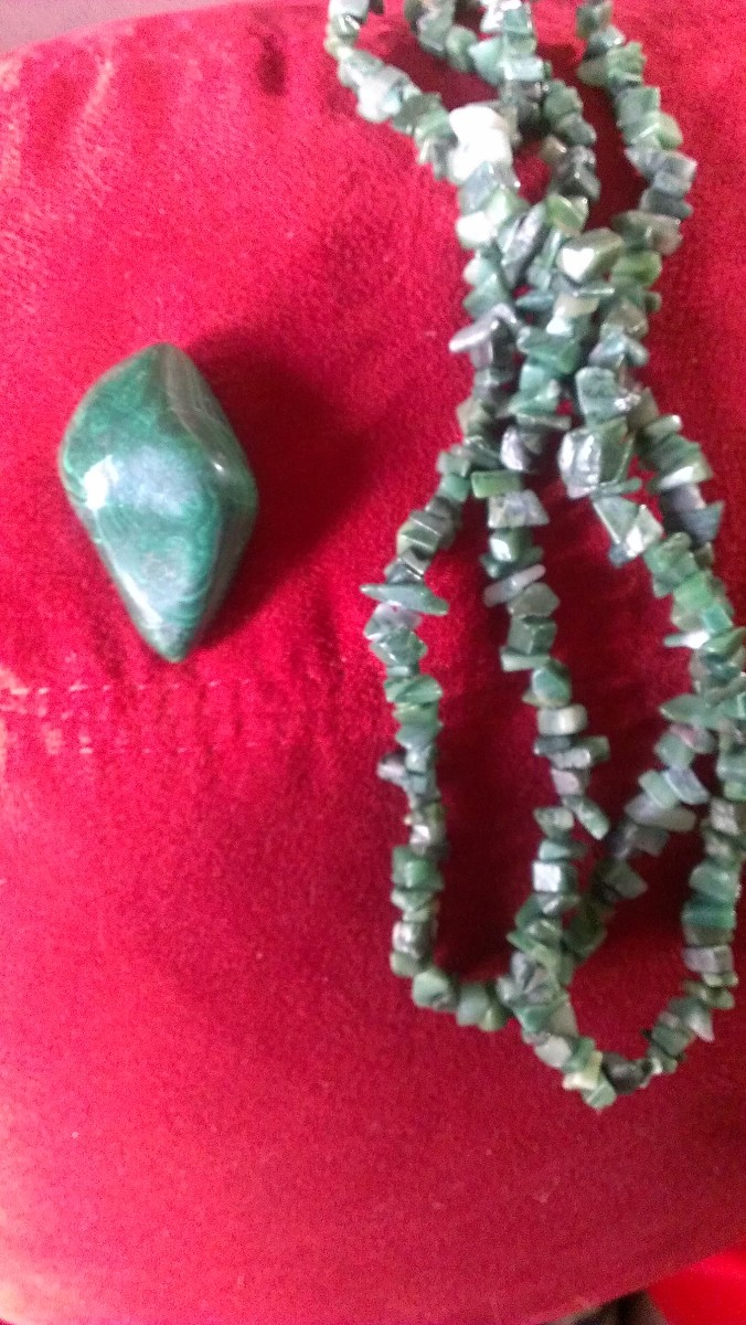 These stones have all been polished. The larger piece is a loose tumbled stone, the small ones only polished and now a necklace. Beads are often sold in these two forms. These forms can be found at wholesalers or retail gift shops.