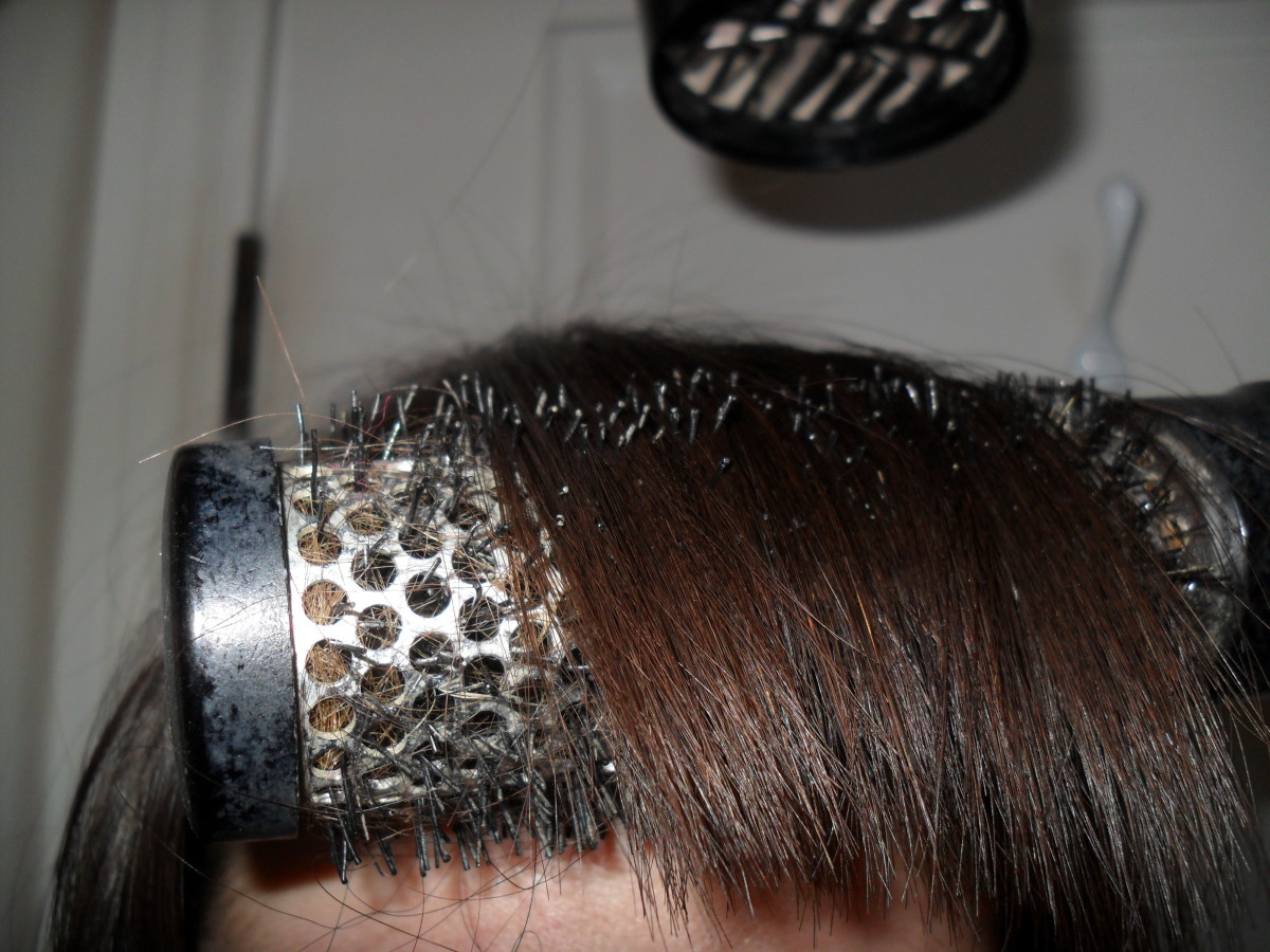 The blow dryer should be drying the area of your bangs that is pulled straight.