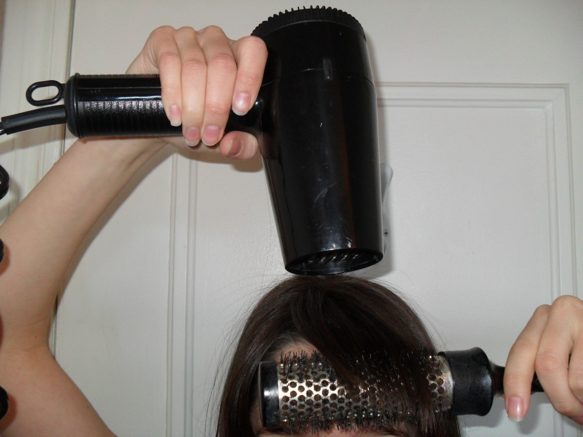 Blow dry your bangs to straighten them