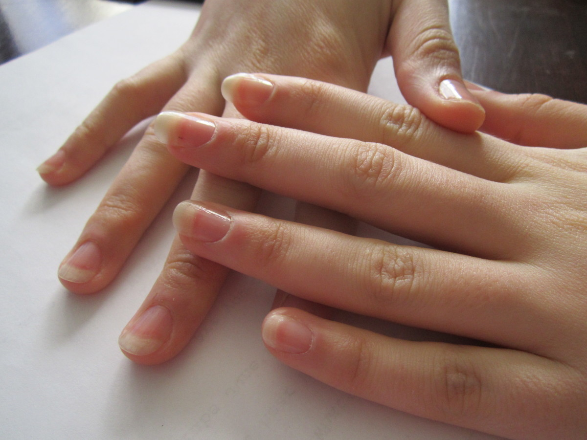 My sister agreed to be my model for this hub.  Her fingers are so long and dainty!  She wanted to file her own nails though, I probably would have rounded them more, but she likes them this way.