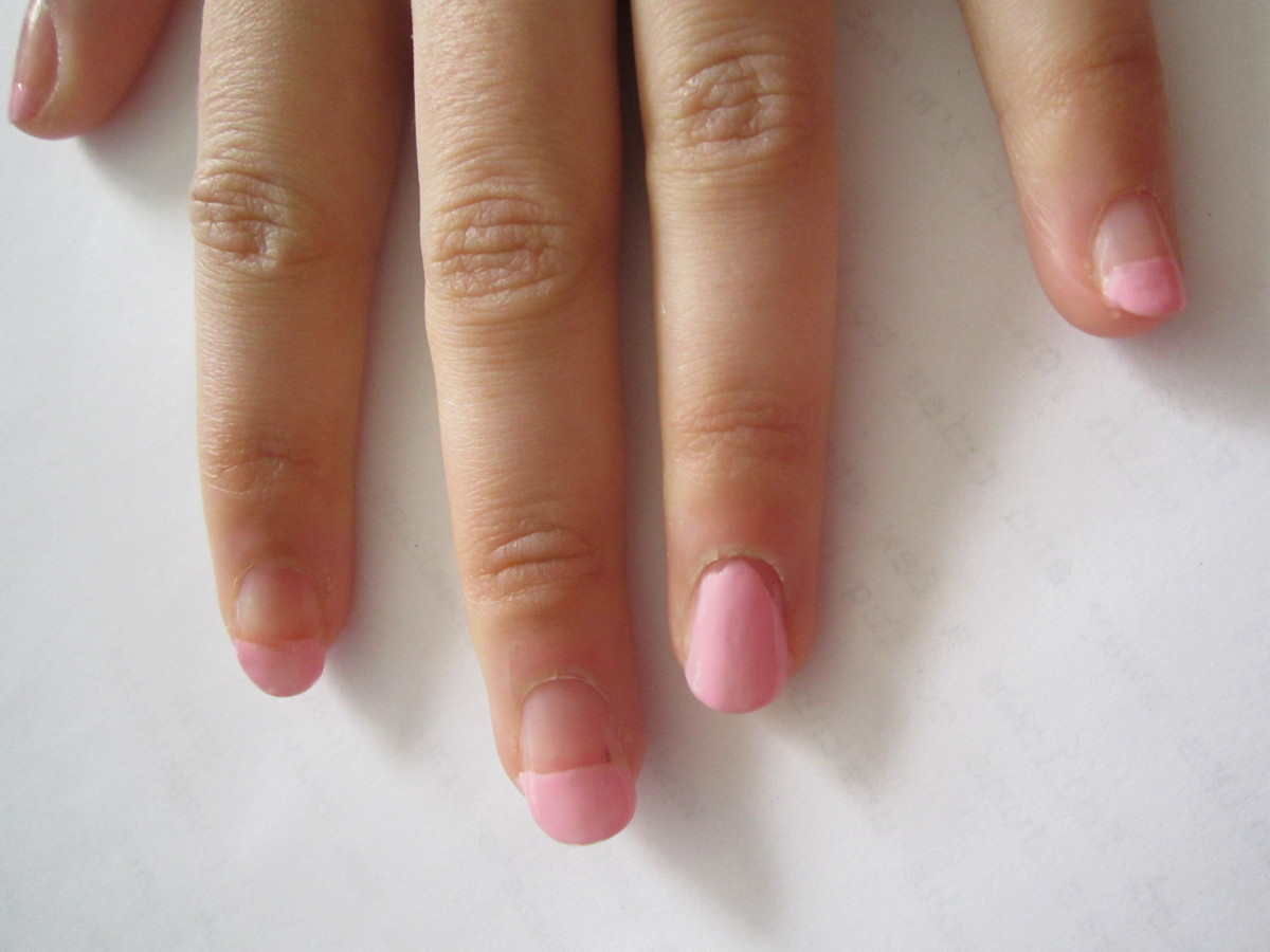 We started with a pink french manicure and painted the ring finger to prep for its design.