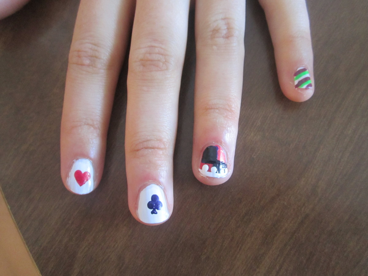 To make your heart into a clover like in this Harley Quinn inspired nail art design, make your two dots, then a third dot on top, and draw the triangle stem with a toothpick.