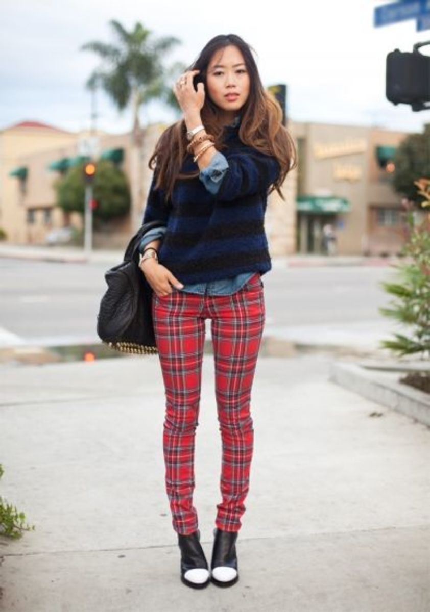 Common plaid with a dark and subtle striped sweater.