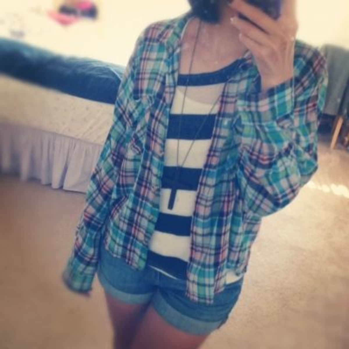 A casual look—flannel top and striped undershirt.