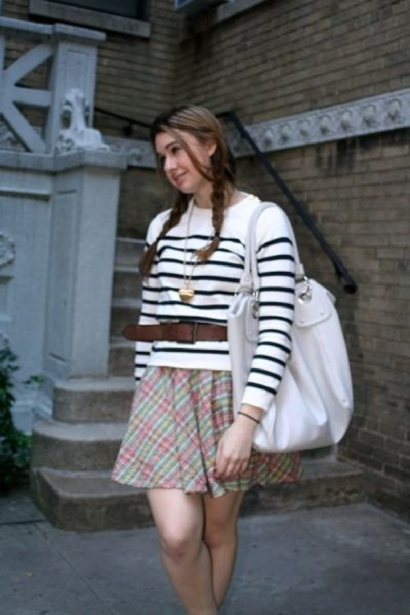 Striped sweater with plaid skirt.