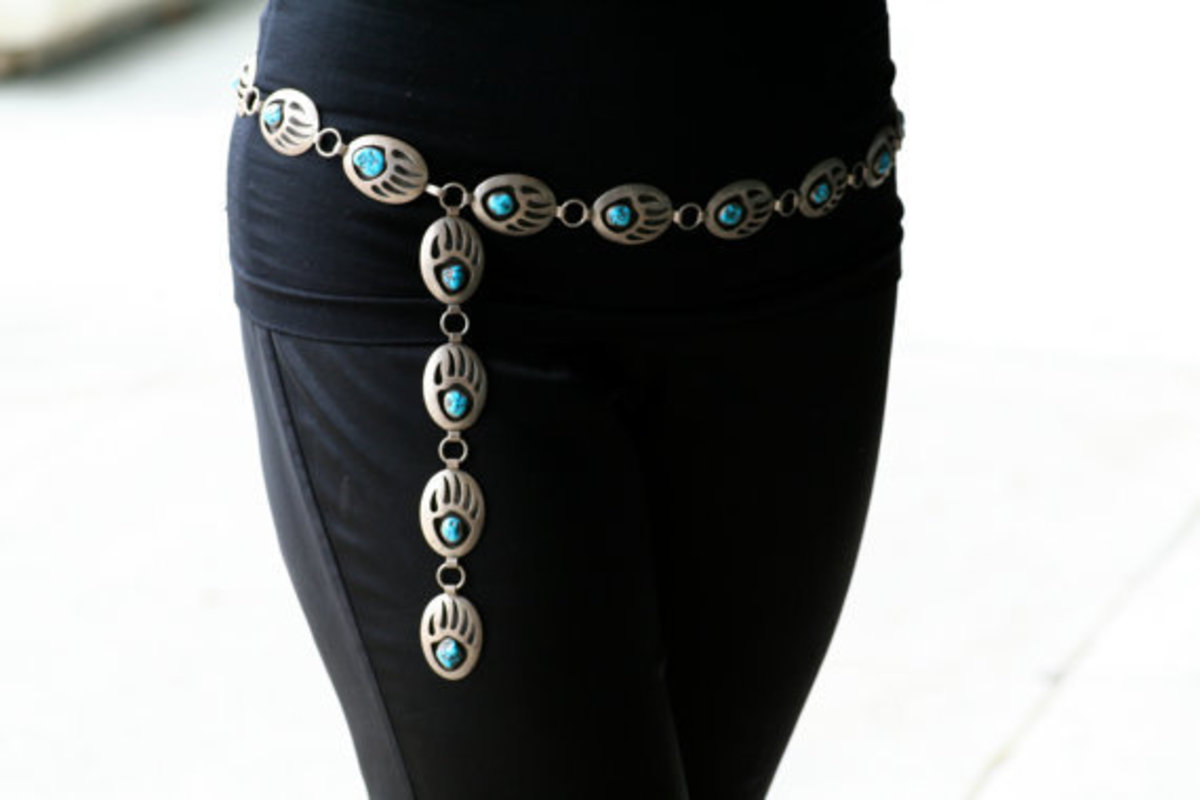 #12 concho belt with turquoise in the bear claw pattern nicely draped black