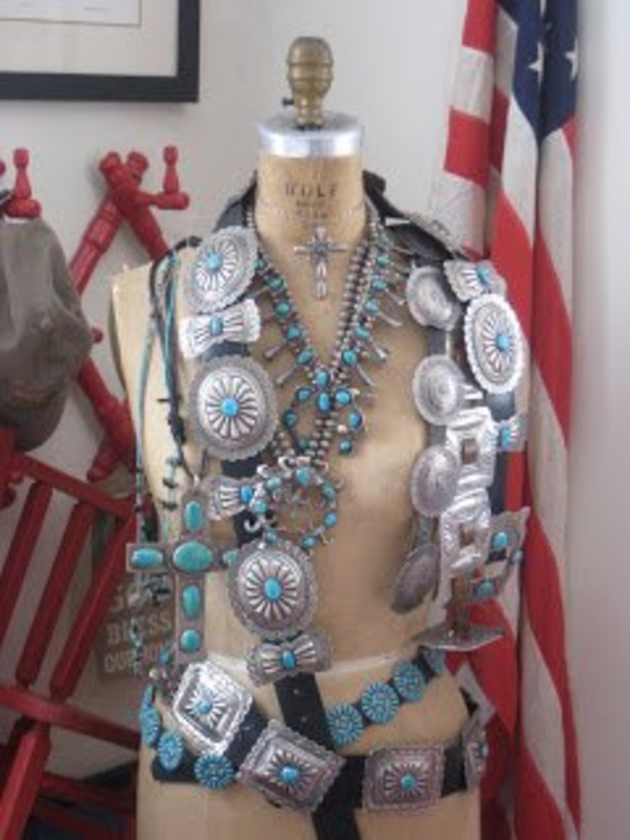 multiple conchos draped over a mannequine with an American flag in the background