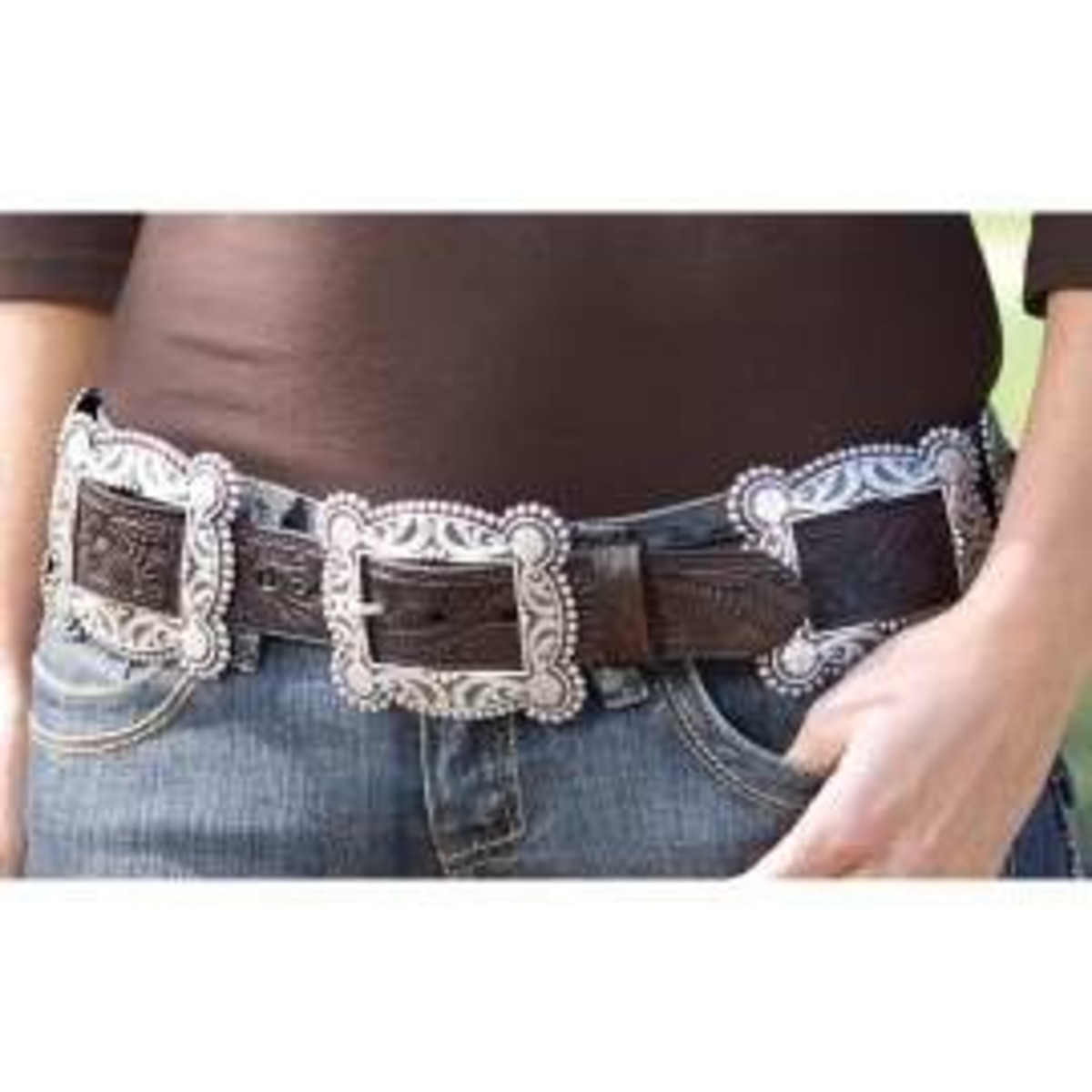 #4 brown leather square concho belt paired with brown shirt and blue jeans