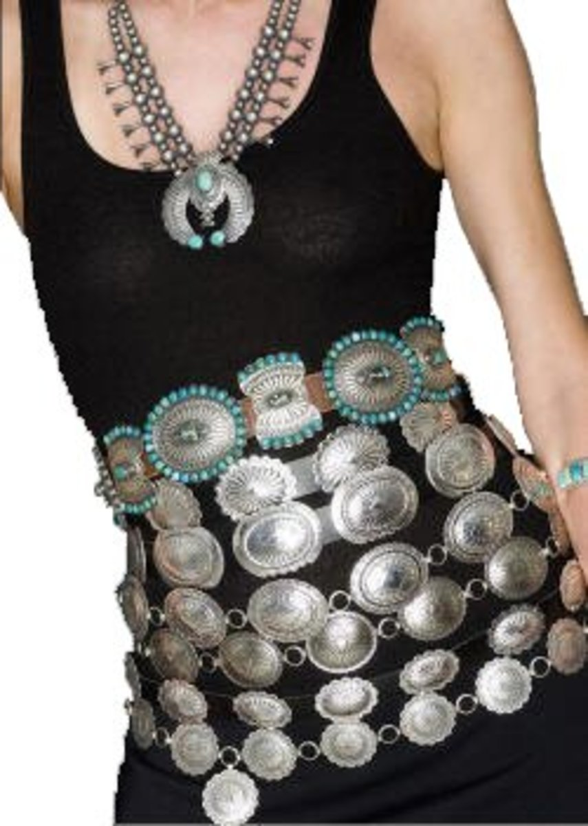 seven concho belts around model waist on black tshirt with turquoise necklace
